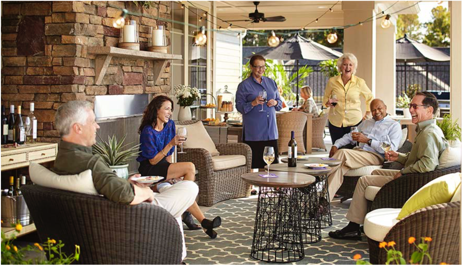 A group of poeple age 55+ having a patio party