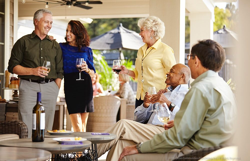 A social gathering of Epcon home owners on a porch