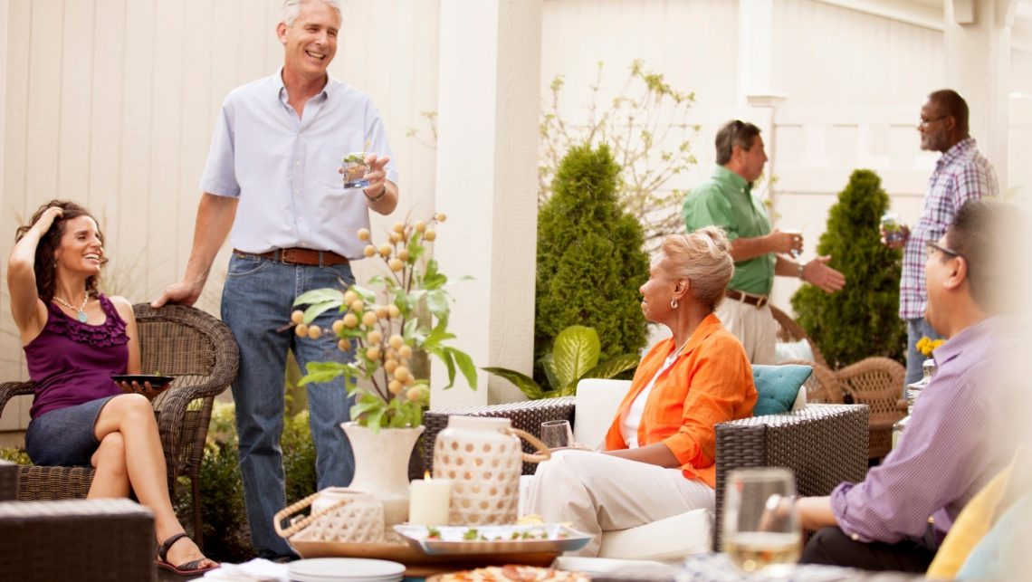 6 people socializing on a Epcon Communities home patio
