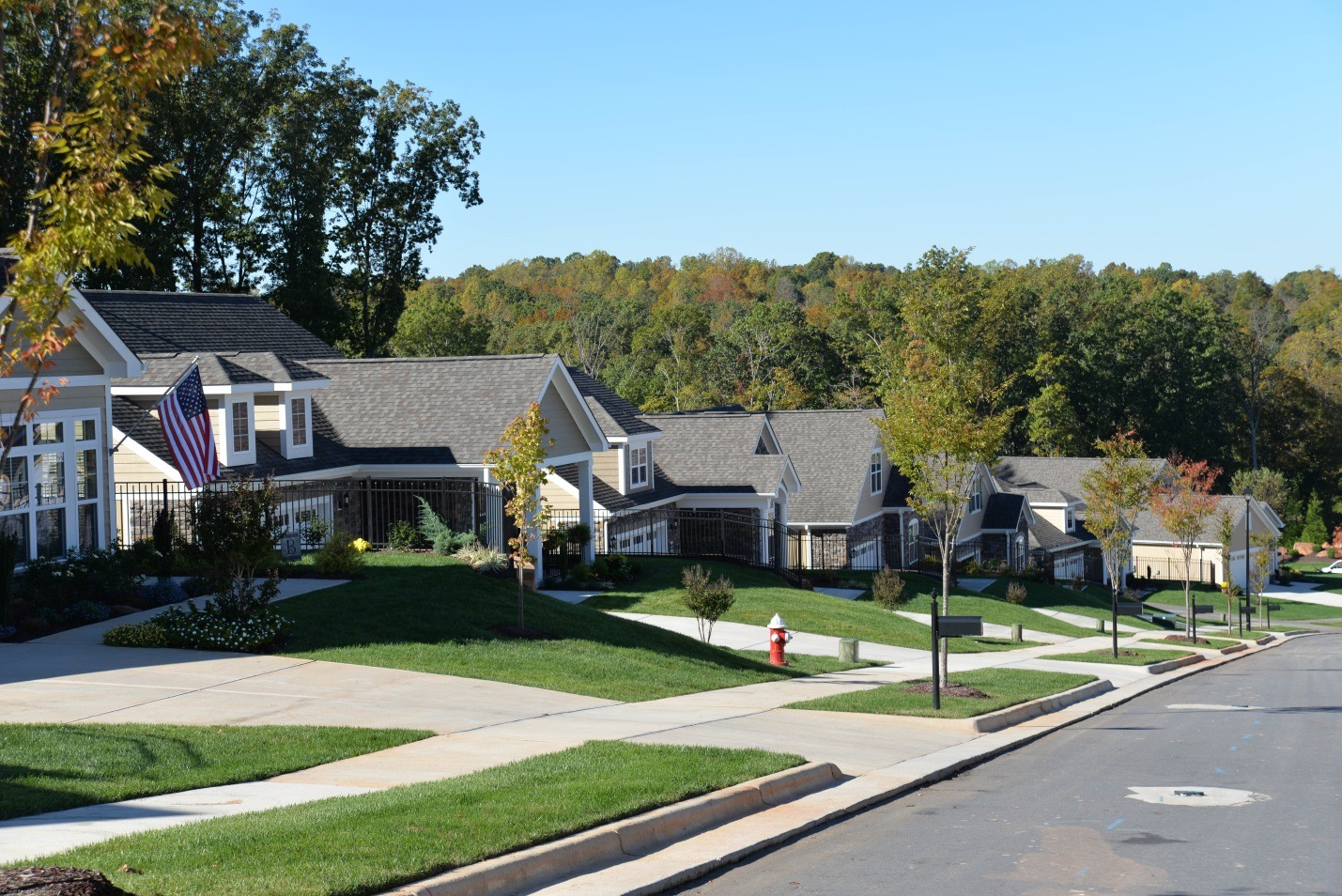A street-view of an row of Epcon Community single-family homes
